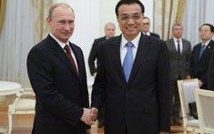 В.Путин встретился с Ли Кэцяном