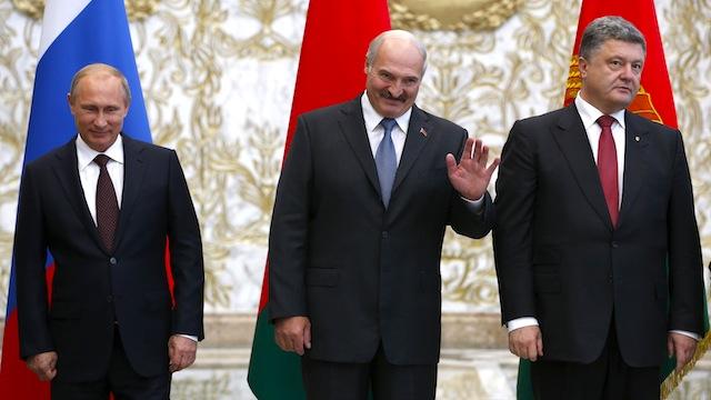 Russia's President Putin, Belarus' President Lukashenko and Ukraine's President Poroshenko pose for a family photo in Minsk